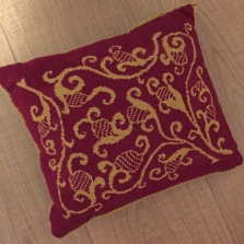 Red and gold chair seat cover designed by Debby Robinson for Medieval Needlepoint (1992)