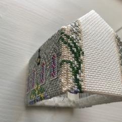 Cross-stitches to hide the seam