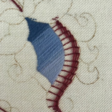 The dark colour of the laid work, which I un-stitched